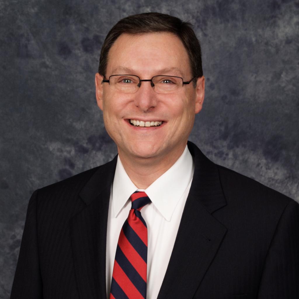 Dr. Claude Kayler